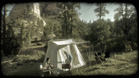Couple camping. Vintage stylized video clip Live Action