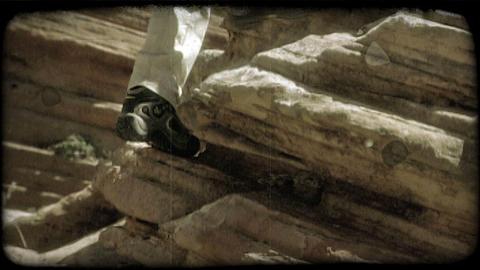 Couple hikes up slaterock. Vintage stylized video clip Footage