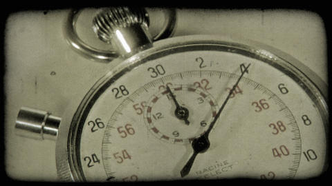 Close-up shot of a stopwatch. Vintage stylized video clip Footage
