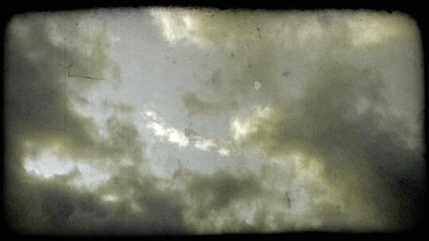 Blue fluffy clouds. Vintage stylized video clip Live Action