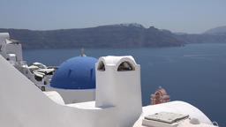 Greece Aegean Sea Cyclades Santorini white chimney and blue culopa in Oia ビデオ