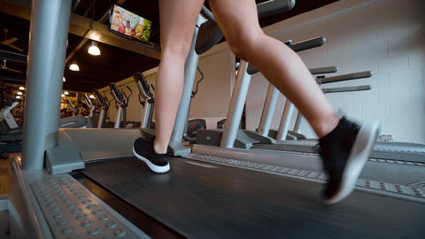 Running for a perfect body - girl at the gym Footage