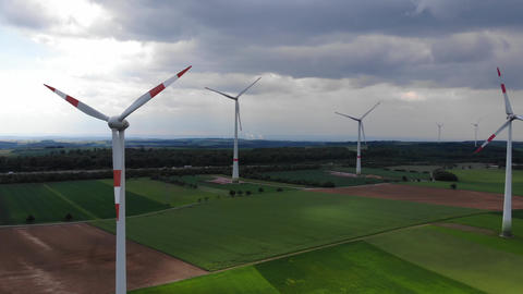 Aerial flight over wind power plants - wind energy mills from above Footage