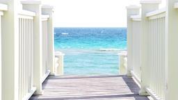 Wooden boardwalk leading to beach ocean or sea access in Seaside, Florida Footage