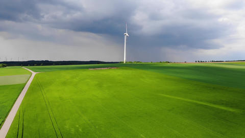Clean ecofriendly energy - wind power plants - aerial view from a drone flight Live Action