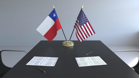 Flags of Chile and the United States of America and papers on the table Footage