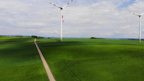Wind energy plant - modern wind power station on a hill - clean energy ビデオ