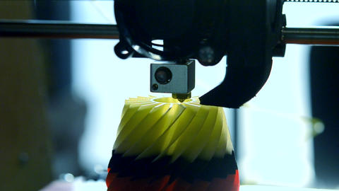3D printer printing an object from plastic Footage