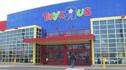 Slow motion of people at Toys R US store with closing, bankruptcy sale sign Footage