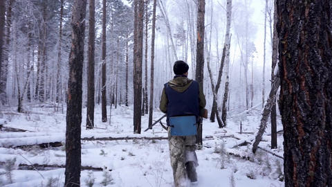 Hunters in the Woods. Armed Rangers in winter forest Live Action