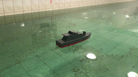 children's ship model is swimming tested in the pool Footage