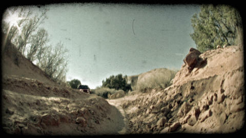 Jeep in dirt ditch. Vintage stylized video clip Live Action