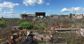 Going through the frame of a destroyed doors house. Sad urban landscape. Backgro Footage