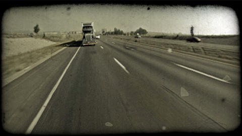Truck drives on freeway. Vintage stylized video clip Footage
