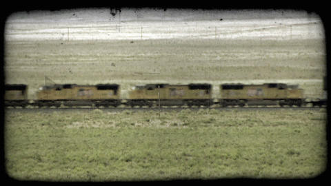 Freight train on prairie. Vintage stylized video clip Footage