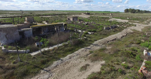 Aerial drone scene of abandoned, demolished, destroyed house in the countryside Footage