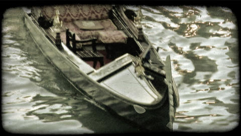 Static shot of a gondolier and his gondola. Vintage stylized video clip Footage