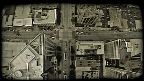 Aerial over buildings. Vintage stylized video clip Footage
