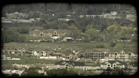 Residential houses in a valley. Vintage stylized video clip Footage