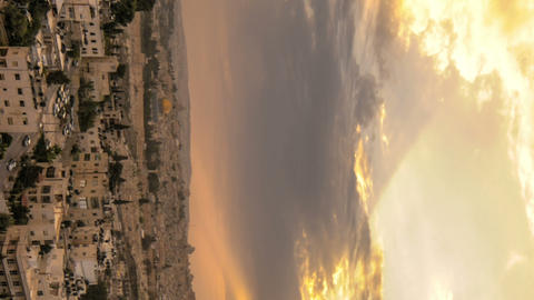 Vertical shot of Cloudy sunset above Jerusalem Footage