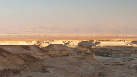 Panoramic shot of shadows moving across desert landscape. Cropped Live Action