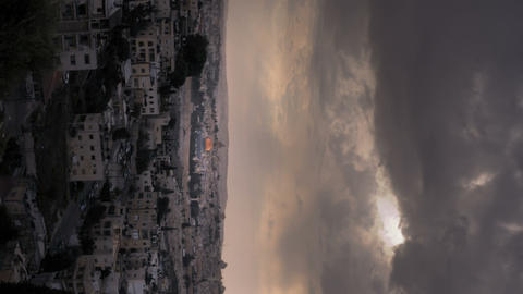 Vertical shot of Time-lapse of the city and sun rays from the BYU Jerusalem cent Footage