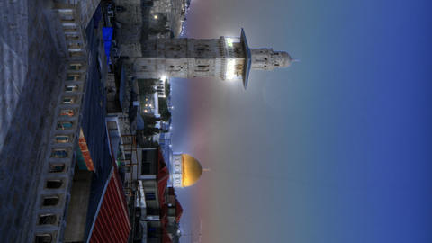 Vertical shot of Time lapse of sunset over Jerusalem rooftops, including Dome of Live Action