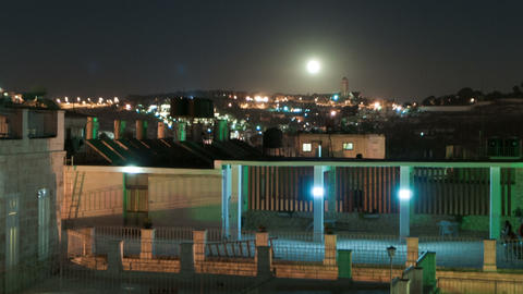 Panning shot of Time lapse of moonrise over Israeli rooftops Footage