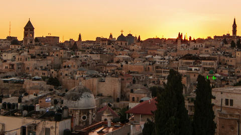 Time lapse of sunset over Jerusalem rooftops. Cropped Footage