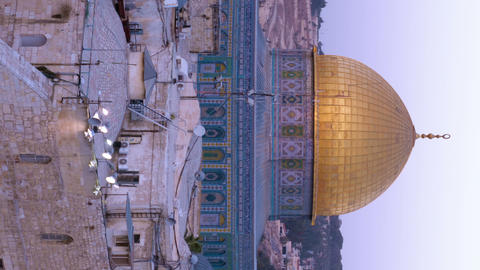 Vertical shot of Close up time lapse of the Dome of the Rock as night falls Footage