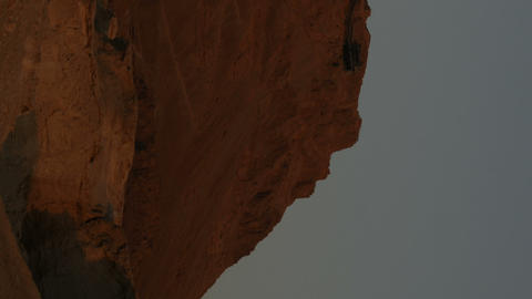Vertical shot of Time lapse of shadow and sunlight on a desert rock formation Footage
