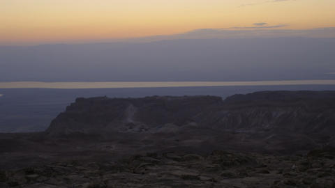 Panning shot of Time-lapse at sunrise in Masada, Israel Footage