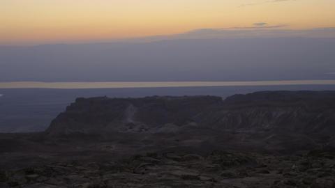 Panning shot of Time-lapse at sunrise in Masada, Israel Footage