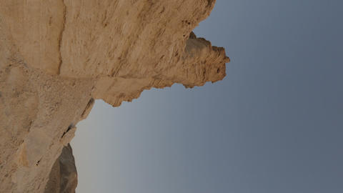 Vertical shot of Shot of a tracking time-lapse of rock formations in Israel Live Action