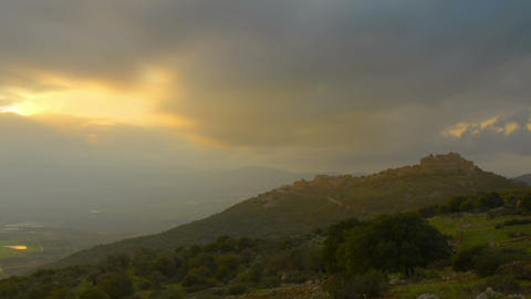 Panning shot of Evening sunset time-lapse in the hills near Nimrod, Israel Footage