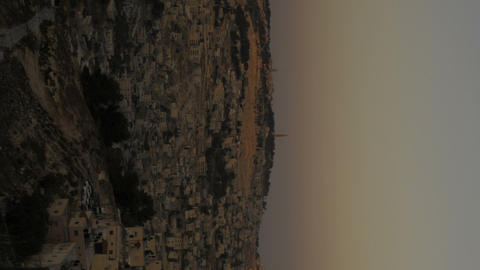 Vertical shot of Sunset from behind shot of Jerusalem Footage