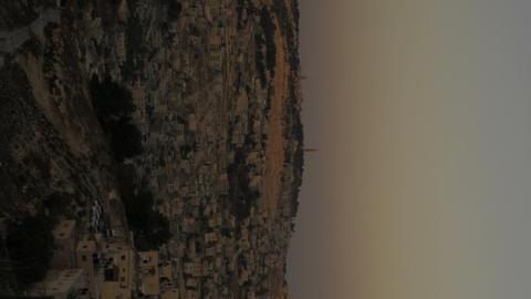 Vertical shot of Sunset from behind shot of Jerusalem Live Action