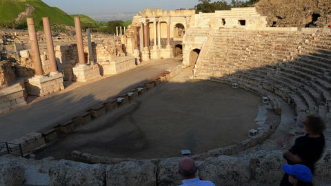 Time lapse of tour groups in an ancient Roman amphitheater. Cropped Footage