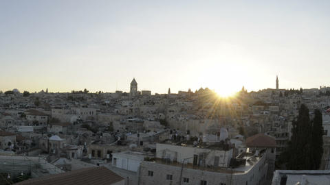 Panning shot of Time lapse of night falling over Jerusalem rooftops Footage