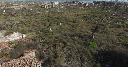 Aerial drone scene of destroyed city by natural catastrophy. Camera flys through Footage