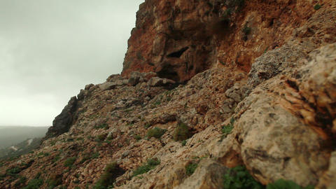 Stock Footage of a cave in a rocky mountainside in Israel Footage