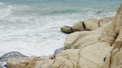 Stock Footage of waves crashing against a rocky, white shore in Israel Footage