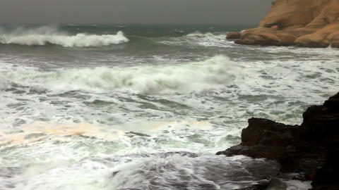 Stock Footage of the spray from waves at a rocky shore in Israel Footage