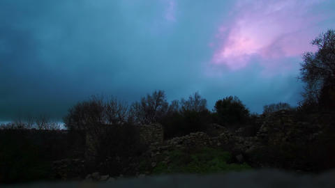 Stock Footage of fast-moving storm clouds over the Bar'am ruins in Israel Footage