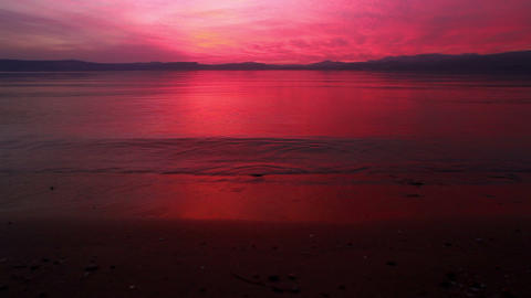 Stock Footage of the sunset reflecting off the Sea of Galilee and its shore in I Footage