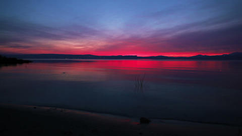 Stock Footage of the sky at sunset reflecting in the Sea of Galilee in Israel Footage