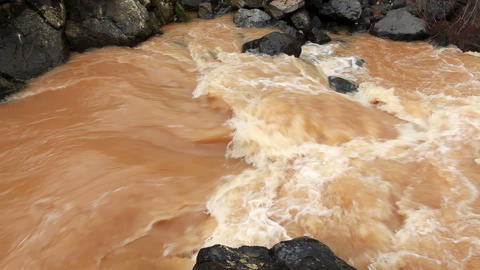 Stock Footage of a turbulent part of a brown river in Israel Footage