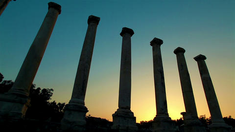 Stock Footage of ancient silhouetted columns at sunset in Israel Footage