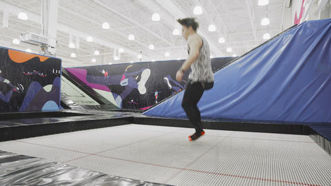 Professional Athlete doing exercise on trampoline Live Action
