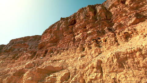 Stock Footage drive-by of rocky desert cliffs in Israel Live Action